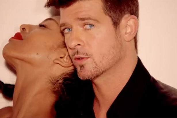 Robin Thicke cuddles with a model in this screenshot from Blurred Lines