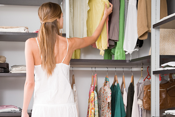 woman looking in her closet
