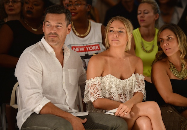 Eddie Cibrian and LeAnn Rimes watching the Luli Fama show during Mercedes-Benz Fashion Week Swim 2015; Image: Getty