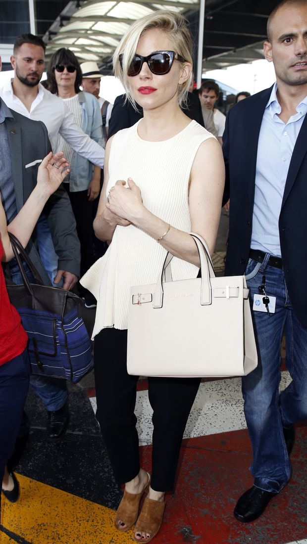 Sienna Miller arrives to the Cannes Film Festival in Stella McCartney