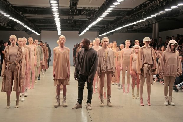 Kanye West poses during the finale of Yeezy Season 2.
