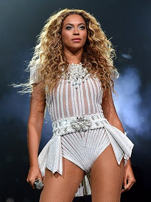 """Beyoncé onstage during her 2013 """"Mrs. Carter Show World Tour."""""""