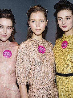 Models backstage at Lela Rose wearing the CFDA's #IStandWithPP pin.