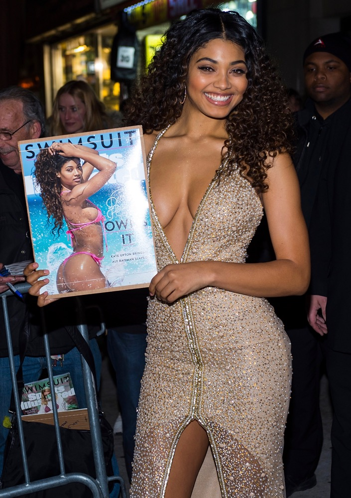 Danielle Herrington holds up her 2018 Sports Illustrated Swimsuit issue.