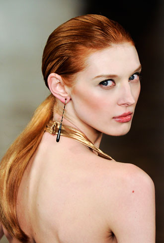 runway image of woman with hair oil