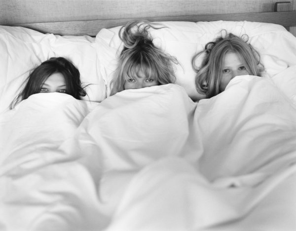 Kate Moss and two other models in bed by Bruce Webber