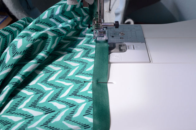 sewing ribbon on skirt